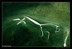 LAND ART:  Uffington White Horse - Uffington, Oxfordshire, England;  the oldest  of the white horses in England - thought to be about 3,000 years old;  374 feet long, formed from deep trenches filled with crushed white chalk;  photo by Frank Laumen