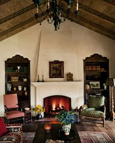 spanish fireplace, interior, spanish colonial decor, bookcas, bookshelv, living room fireplace, hacienda fireplace, hacienda living room, design