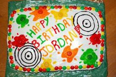 Homemade Paintball Cake: I made this Paintball Cake for my son's 12th birthday. It is a white frosted 12x9 in. cake. The paint splats, wording, and bulls eyes are gel.  Chocolate