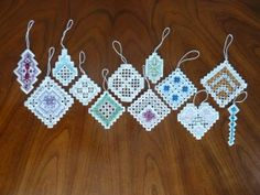 Make something special for each special person in your life this Christmas with this collection of birthstone-inspired Christmas ornaments worked in Hardanger embroidery.  Each ornament features silk overdyed threads and Swarovski crystals.  Luxurious!