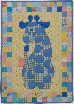 """Gerome the Giraffe"" - part #2 of my district scholarship, and I have now resigned myself to the fact that with all the small curved applique, this might have to be a wall hanging, and not a baby quilt. But for my first applique quilt, I'm pretty proud :)"