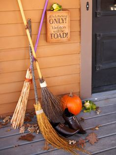 Wrap twigs around wooden dowels to make this cute front door display. More eerie Halloween decor: http://www.bhg.com/halloween/outdoor-decorations/halloween-outdoor-makeover/?socsrc=bhgpin091612witchesbroomporch=23