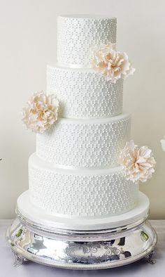 Elegant white dot detail with cream open peonies wedding cake