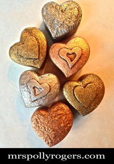Click here to DIY Metallic Leafed Dollar Tree Plastic Hearts from MrsPollyRogers.com (these would make cute magnets...J)