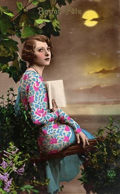 vintage: woman at water's edge in moonlight with a book