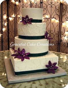 Ivory Wedding Cake with Purple Stargazers and Clover Green Ribbon by Graceful Cake Creations, via Flickr