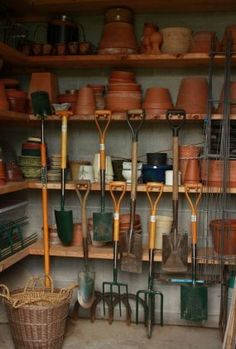 Garden Room shelving and tool hooks. Fine Gardening.