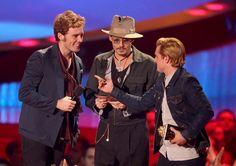 i think Josh is scolding Sam for eating Johnnys hat