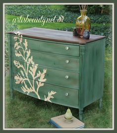 Awesome refinished dresser.  Love the stencil!