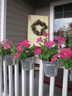 Galvanized buckets for flowers - cute idea!