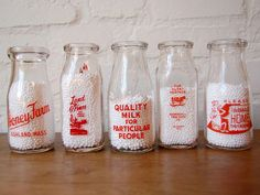 Antique Milk Bottles, Bruce just gave me 2 from StAndrews Milk Delivery in Panama City. Cant wait to use them for flower vases.  I love them.