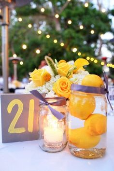 How about this tri with plums, limes and tangerines, kiwis with you puple white and green arrangements.  Dont like the ribbin, maybe grograin around the jars?  Gray and Yellow Summer Wedding Wedding Flowers Photos on WeddingWire