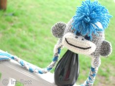 Handmade crocheted sock monkey hat with blue Mohawk.  Your child will go bananas for this cute animal hat