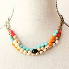 Triple Strand Colorblock Beaded Necklace.