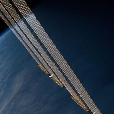 Aboard the International Space Station, NASA astronaut Karen Nyberg caught the reflection of Earth's horizon on the station%u2019s solar arrays at sunset on Sept. 18.