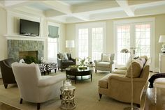 Paint color on coffered ceiling is Benjamin Moore Ice Blue 2052-70; the walls are in Benjamin Moore Manchester Tan HC-81