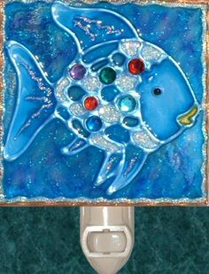 Handmade Rainbow Jewels Fish Nightlight. Stained glass beach and ocean theme night light hand painted on textured art glass for kids, children, nursery and bathroom decor. Decorative creative artwork made by Pat Desmarais in the USA. $22.00