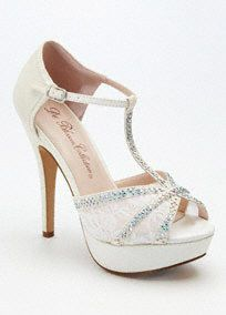 """Step out in style in these high voltage T-strap sandals!  High heel platform pump with t-strap has crystal and lace detailing.  Buckle closure.  Heel height: 4 3/4"""".  Available in Champagne, Silver Metallic and White.  Imported."""