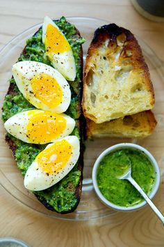 Meet: The Only Green Sauce You Need. Smear on toast. Drizzle over eggs. Or eat, as here, with jammy, 7-minute eggs. There is nothing you won't want to slather this sauce on: grilled vegetables, cheese sandwiches, savory yogurt bowls, roast chicken... the possibilities are endless. It's made with herbs, avocado, olive oil, lemon, garlic, salt and pepper ... comes together in no time. #avocados #greensauce #sevenminuteeggs #sourdough #toast #eggs #jammyeggs #sevenminuteeggs