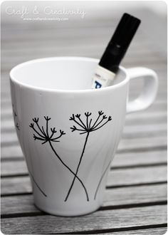 Design your own mugs - by Craft & Creativity -- since you can write and draw whatever you want, throw it in the oven...it's super easy to make for anyone.