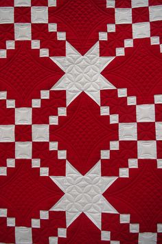 Red & White Quilt |  Lovely piecing and quilting.  The blocks appear to be made with 4-patches and solid squares and the stars are formed in the sashing.