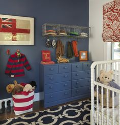 vintage wire baskets on the wall as storage with hooks for hanging hats and jackets. Too cute