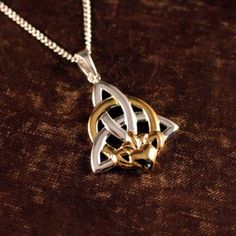 Irish Claddagh Trinity Knot Necklace-- I have this tattoo on my back.. I'd like this in white gold