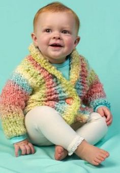 Featuring a plush cowl collar, the Rainbow Clouds Baby Cardi is sure to keep baby nice and cozy.