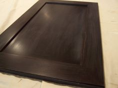 ottoman tray made from repurposed cabinet door