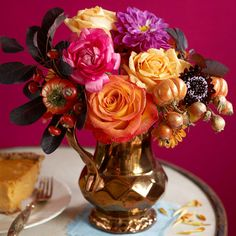 A gilded pitcher is the perfect home for a bright fall bouquet of roses, dahlias, and rose hips. More fall centerpieces: www.bhg.com/decorating/seasonal/fall/fabulous-fall-centerpieces/?socsrc=bhgpin100512colorfulrosecenterpiece#page=7