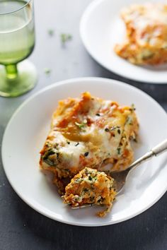 Skinny Spinach Lasagna: layers of ricotta, spinach, noodles, sauce and cheese.