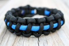 $12 Thin Blue Line paracord bracelet. $2 from each sale goes to Police Charity, www.odmp.org to honor law enforcement officers killed in the line of duty.