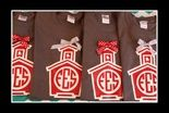 Schoolhouse Monogram tees with the school's initials!  Photo shows Char Gray with red/white design.