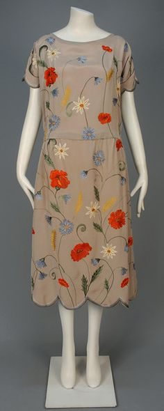 1920-1924 TAMBOUR EMBROIDERED SILK DRESS: Taupe silk with scalloped short sleeve and hem decorated with polychrome scrolling floral embroidery, chiffon lining.