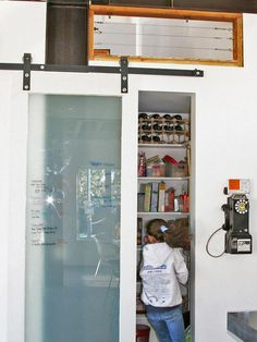 Sliding Glass Barn Door Hides Kitchen Pantry