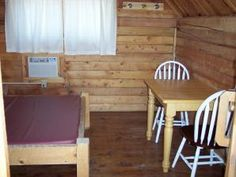Hot Springs KOA - want to get away?  Stay in our couples cabin that features a walk around full size bed, night stand, small desk, table w/ chairs, AC plus a ceiling fan, porch w/ porch swing, BBQ and picnic table.