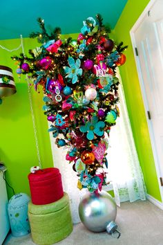 Peace Love and Christmas Upside Down  The upside down tree rocks a tweens room and leaves plenty of floor space for lounging. Hot colors of turquoise, hot pink and lime green compliment the room