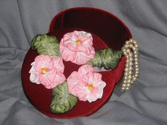 My own work on a hat box I covered in velvet. Pink pansy's in French silk ribbon.