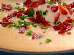 Food Network invites you to try this Fully Loaded Cheesy Potato Soup recipe from Patrick and Gina Neely.