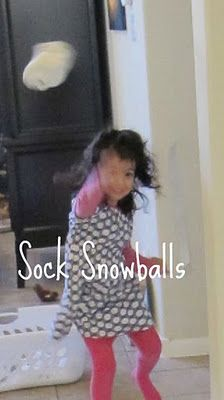 Indoor snowballs - using white socks balled up!