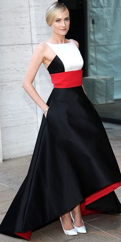 09/24/13: At the Metropolitan Opera House, Diane Kruger was breathtaking in a red-white-and-black satin Prabal Gurung creation with a full skirt and a high-low hem. A bracelet, onyx earrings and white Casadei pumps served as accessories. #lookoftheday
