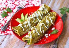Avocado and black bean enchiladas via @SheKnows/  // #avocado #blackbean #MeatlessMonday #enchiladas #recipe