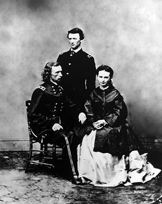 Another postwar photo taken by Matthew Brady in Washinton.  GAC, his brother, Tom Custer, and Libbie.