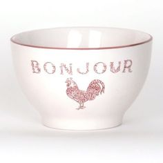 Part of our farmhouse dining collection, the white Bonjour soup bowl comes trimmed in red with a decorative rooster stamp under the lightly distressed script. #kirklands #frenchcountrydining #bonjour #soupbowl