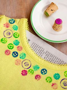 Dotty Stamps: Glue a button to the end of a cork. Place newspaper inside a cotton shirt, then dilute fabric paint with a small amount of water. Brush a thin layer of paint on the button and stamp it onto the shirt. To make prints on paper, simply use a regular ink pad.    Originally published in the March 2013 issue of FamilyFun
