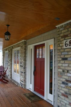 Front door and trim colors pullled from multicolored brick.