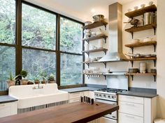 Smart Kitchen Storage Tip:  Stash Stuff in Plain Sight!  Open shelves provide plenty of storage while keeping everyday serveware, pots and pans within easy reach. Photo courtesy of The Brooklyn Home Company
