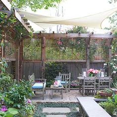 Outdoor canopy and arbor fence for privacy.