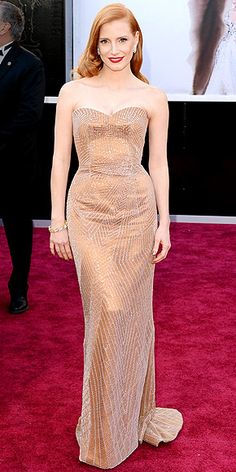Jessica Chastain looks stunning in her copper embellished custom Giorgio Armani gown, accessorized with Harry Winston diamonds, soft waves and the perfect red lip. http://www.peoplestylewatch.com/people/stylewatch/package/gallery/0,,20658247_20672194,00.html#