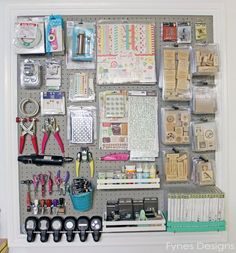 Craft Room Organizing Ideas-some great tips for hanging stuff on my pegboard. Binder clips for fabric. Crates resting on long arm pegs. Good stuff.